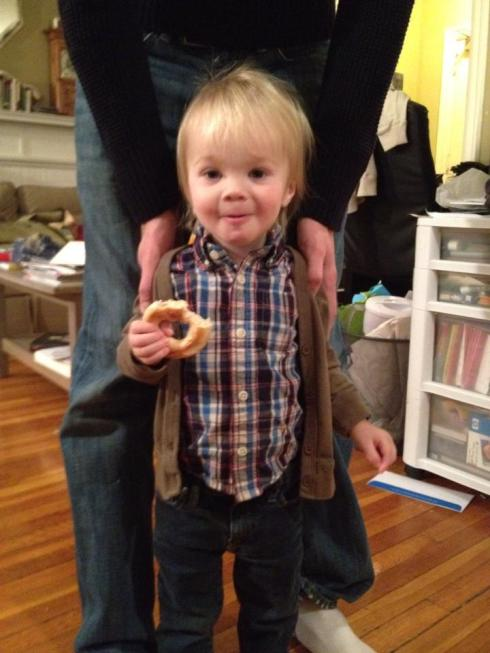 Unwilling to put down his bagel, even for a birthday picture.